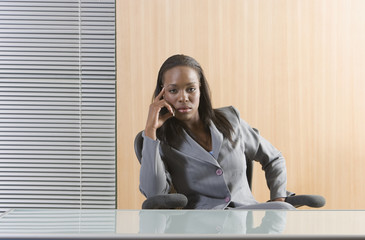 Businesswoman sitting behind an empty desk