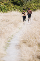 Couple jogging on gravel path