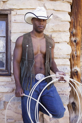Young man in cowboy outfit posing for the camera