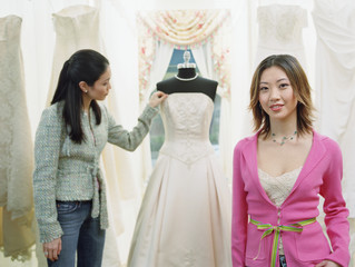 Young woman standing in a bridal boutique