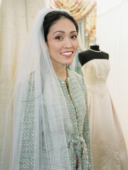 Young woman wearing a bridal veil