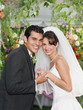 Newlywed couple smiling for the camera