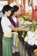 Two women shopping for produce