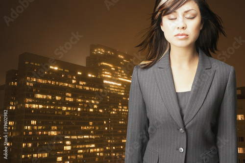 Businesswoman relaxing in front of city landscape