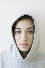 Portrait of teenage girl wearing hood