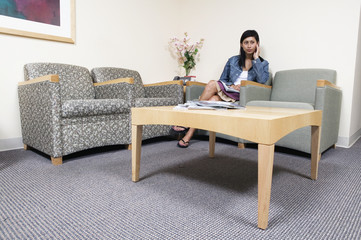 Woman sitting in waiting room