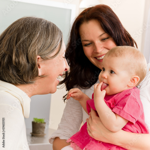 Happy family women - grandmother, mum and baby
