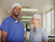 Male and female surgeons posing