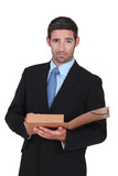 businessman holding a folder