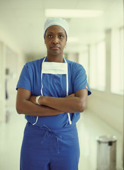 Female surgeon in hospital hallway