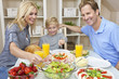 Parents Child Family Healthy Food & Salad At Dining Table