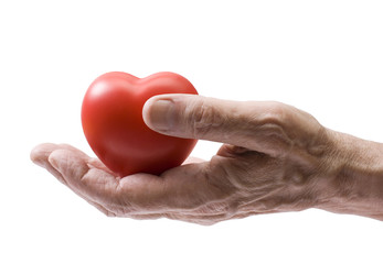 Old hand with red heart. Clipping path included.