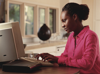 Young woman typing on computer