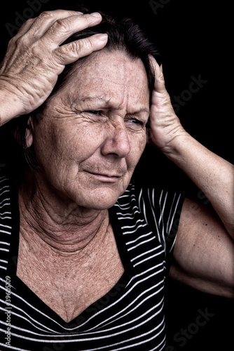 Grunge portrait of a stressed old woman