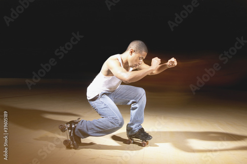Young man performing dance on roller skates