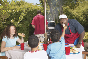 Family at a backyard barbecue