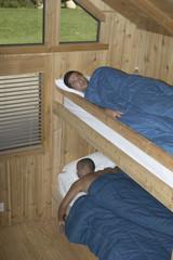 Men sleeping in bunk beds