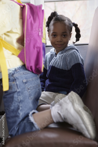 Portrait of girl on school bus
