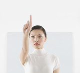 Woman with finger pointed upward