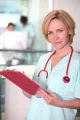 Blond nurse at work.