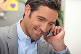 man passing a phone call