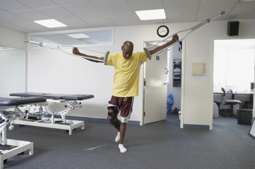 Man walking with crutches in air