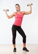 Beautiful woman doing fitness exercise with dumbbellls.
