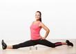 Beautiful athlete woman doing splits.