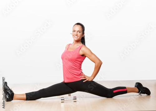 Beautiful athlete woman doing splits.