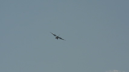 Military transport airplane in flight