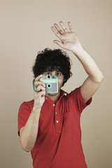 Young man taking a picture