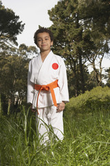 Young boy wearing karate outfit