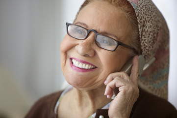Elderly woman talking on cell phone