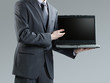 Businessman holding his laptop