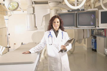 Female doctor standing in empty operating room