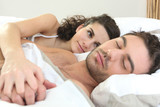 Woman watching her husband sleeping