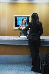 Hotel clerk assisting customer