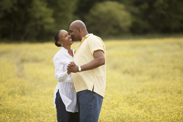 Couple dancing together in field