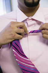 Businessman removing tie