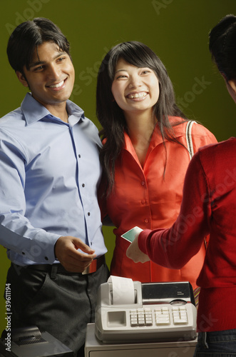 Couple making credit card purchase