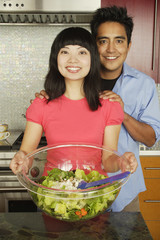 Couple with salad serving bowl