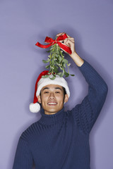 Young man with mistletoe