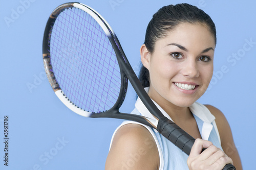 Teen girl posing with tennis racquet