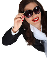 Brunette businesswoman wearing sunglasses