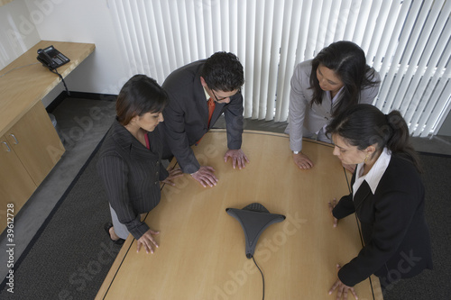 Business professionals using speaker phone
