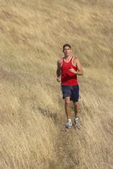 Male runner in golden field