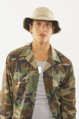 Portrait of young male soldier in fatigues
