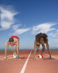 Male track runners prepare to race