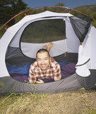 Man lying down inside tent
