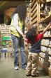 African American mother and young son at health food store